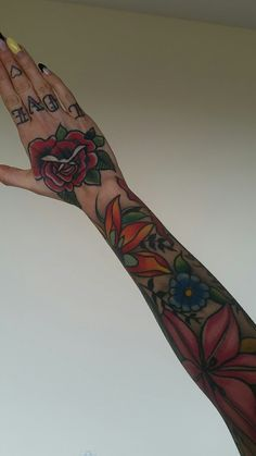 Flowers tattoo ink arms