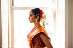 South Indian bride. Gold Indian bridal jewelry.Temple jewelry. Jhumkis. Orange and gold silk kanchipuram sari.Side braid with fresh jasmine flowers. Tamil bride. Telugu bride. Kannada bride. Hindu bride. Malayalee bride.Kerala bride.South Indian wedding.