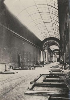 "Louvre Museum. The empty and abandoned ""Grande Galérie"" after the evacuation of the treasures at World War II offspring. Masterpieces, including the Mona Lisa, were moved by volunteers throughout the French countryside throughout the war to keep away from the occupying Nazi troops."