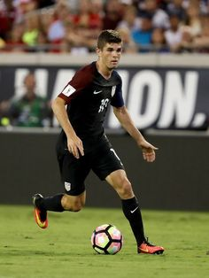 Christian Pulisic #10 of the United States looks to pass during the FIFA 2018…