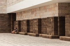 black cork wall by josé neves becomes urban furniture in lisbon