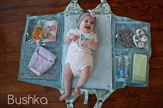Bushka diaper bag that unfolds into changing pad and pockets (a bit steeply priced, but a great idea!)