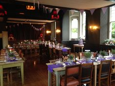 Bunting & purple runners for this wedding at The Battleaxes in Wraxhall.  Styling by www.littleweddinghelper.co.uk