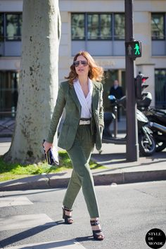 An olive green pantsuit looks feminine yet fashion forward in this #StreetStyle shot