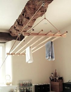 hanging clothes dryer on pulleys; excellent idea in place of those fragile bulky eyesores while also extending the life of your clothes and saving a little space.