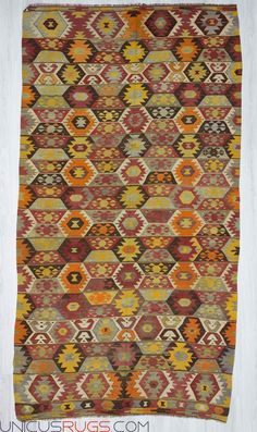 "Handwoven vintage kilim rug from denizli region of Turkey. In very good condition. Approximately 55-65 years old. Wool on wool Width: 5' 7"" - Length: 10' 6""  Colorful Kilims"