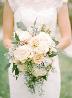 romantic ivory rose bouquet with seeded eucalyptus, dusty miller and wax flower by Brundage Lane Florist