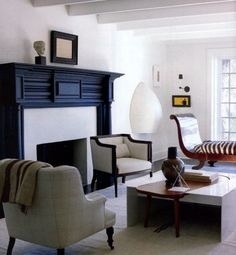 THE LIVING ROOM- ARTFULLY ARRANGED FURNITURE, ECLECTIC ART, BLACK ACCENTS- DARRYL CARTER SIGNATURES!