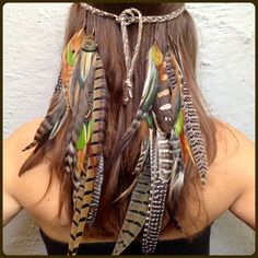 Hey, I found this really awesome Etsy listing at http://www.etsy.com/listing/69755155/headbandhatband-lots-of-feathers-and