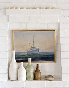 sail boat painting with vases against white brick_nice