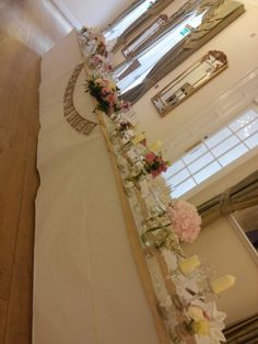 Top table fully dressed with our runners, Just married sign, jars, candles and flowers. There is also 4 empty vases to place the bridesmaids bouquets in! The Garden studio www.gardenstudioevents.co.uk