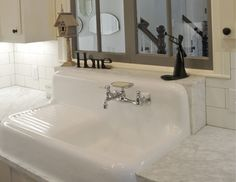 Drainboard Sink & Reclaimed Farmhouse Windows add some charm!