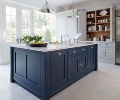 Kitchen island paint color: Hague Blue by Farrow and Ball Tile Mountain Related Stories Flint Pigeon and Wimborne White Nocturnal Sea