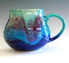 beautiful pottery. I'd be happy to drink my coffee out of this mug every morning.