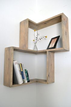 Corner box shelf. This would be cool in the corner of our living room