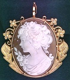Cameo brooch.  I want one to pin to a high-collar blouse under a strapless sheath dress.