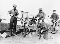 Canadian troops repairing rifles and a bicycle on Salisbury Plain on, preparing to go to war, 27 September 1914