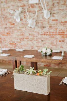 Concrete block wedding centerpiece filled with succulents ~ we ❤ this! moncheribridals.com