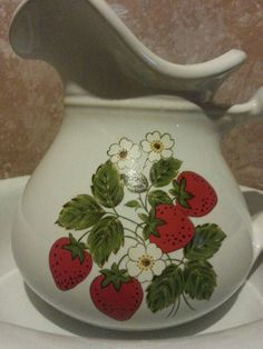Check out this item in my Etsy shop https://www.etsy.com/listing/222061078/mccoy-strawberry-pitcher-and-bowl