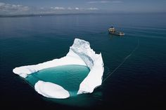 Towing an iceberg offshore Newfoundland - lol that's kinda funny. To be able to tow an iceberg Newfoundland Canada, Newfoundland And Labrador, Newfoundland Icebergs, National Geographic, Gros Morne, Oil Platform, Beach Hacks, Amazing Nature, Beautiful World