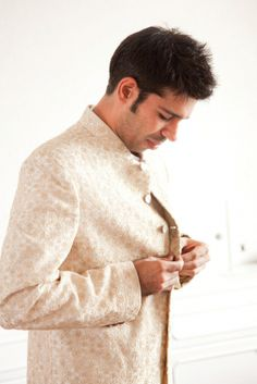 Indian groom with white sherwani | Christine Chang Photography | Rubies and Ribbon blog http://www.christinechangphoto.com/