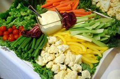 Crudite Platter :: broccoli, cauliflower, baby carrots, celery, tomatoes, steamed asparagus, red and yellow bell peppers, green beans, and fresh herbs