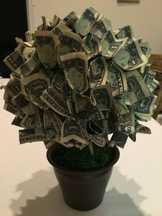 Flowers made of money origami money flower gift wedding gifts i used green barb wire a green styrofoam ball 75 one dollar bills a pot fake grass burlap will do too i literally twisted a small mightylinksfo