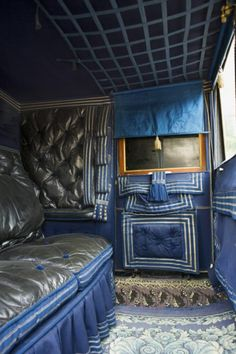"""Interior of the Antrobus travelling chariot at the National Trust Carriage Museum at Arlington Court."""
