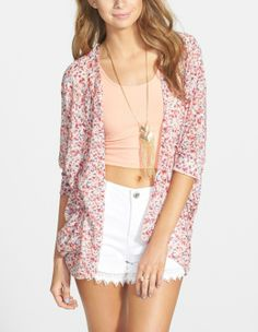 Cute floral print on this dolman sleeve knit cardigan.