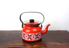 Company: Finel Type: Tea Kettle Size: Small Color: Red with Black and White Details Materials: Enameled Steel Description: Red floral enamel