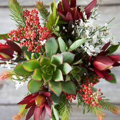 Safari sunset, pepper berry, evergreen accents and has a beautiful centerpiece succulent.