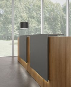 Z2 reception desk with integrated light. Half Moon table light by Karboxx