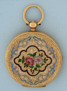 Lovely 18K gold and enamel Swiss keywind antique pendant watch by Albaret Freres circa 1860. The back engraved overall and centered with painted flowers within various colored enamel borders (restoration). Engraved gold dial with blued steel hands. The dust cover with the name of the English retailer, a highly respected watchmaker. Gilt 10 jewel cylinder movement.