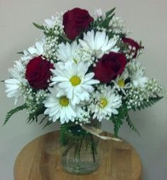 Jar with Burlap and Raffia: Red Roses, White Daisies and Babys Breath