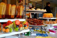 Excellent brunch ideas...french toast sticks in syrup, cute fruit salad cups, BACON on skewers!!!