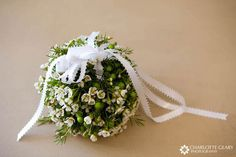 Green and white pomander for a flower girl (from charlottegeary.com)