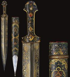Persian / Caucasus qama (double edged dagger) 18th to 19th century, broad straight blade with central groove decorated with damascened cartouches of foliate motifs, horn and marine ivory grips with an intricate arabesque of lotus palmettes, scrolling tendrils and cloud-bands in gold and painted, scabbard with painted decoration and silver lower chape, the upper mount of steel with gold damascening, 58.7cm.