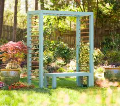 the painted color is not my thing but a very cool modern twist on an arbor or trellis!