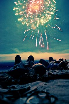 That's just beautiful. Best friends on a beach under the fireworks...perfect moment.
