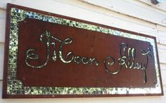 Mirror Tiled Background and Metal Top Layer Store Sign. Sign for a shop in Murphy, CA.