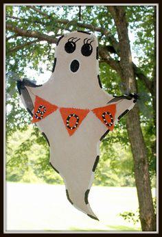 Custom Made to Order Shabby Chic Halloween Ghost Burlap Door Hanger. $28.00, via Etsy.