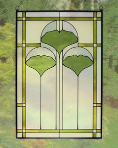 """The striking new 20.5'"""" Arts and Crafts Ginkgo stained glass panel is hand made in the USA with color palette of Greens, Olives, Creams and Frosted Clear. Ht: 20.5"""". W: 14""""."""