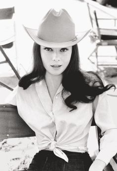Audrey Hepburn in Cowboy Hat (1958) by Bob Willoughby I've never seen her in a picture like this! I LOVE it! Her eyes and hair are mesmerizing!