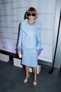 Anna Wintour attends the Gordon Parks Centennial Gala at the Museum of Modern Art in New York City. The famous Vogue editor wears a blue dress and jacket as well as her trademark sunglasses. Sip With Socialites http://sipwithsocialites.com/