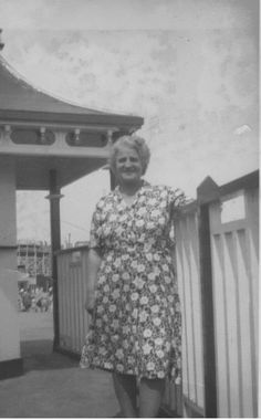 My lovely Mum in Dreamland Amusement Park,  Margate in the 1950s, at the scenic railway entrance, she took the money.