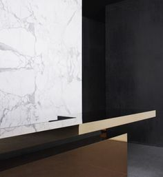 Glossy counter + white marble + black walls. Alexander Wang flagshipstore in Beijing by Joseph Dirand.