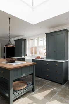 The Hampton Court Kitchen by deVOL painted in a bespoke paint colour with Umbria. The Hampton Court Kitchen by deVOL painted in a bespoke paint colour with Umbrian Limestone flagstones throughout. Kitchen Paint, New Kitchen, Vintage Kitchen, Knobs For Kitchen Cabinets, Kitchen Unit Handles, Kitchen Cupboard Colours, Painted Kitchen Island, Grey Painted Kitchen, Medium Kitchen