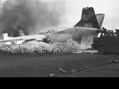 An American C-123 cargo plane burns after being hit by communist mortars while taxiing on the Marine post at Khe Sanh, South Vietnam on March 1, 1968. (AP Photo/Peter Arnett) http://www.pinterest.com/jr88rules/vietnam-war-memories/ #VietnamMemories