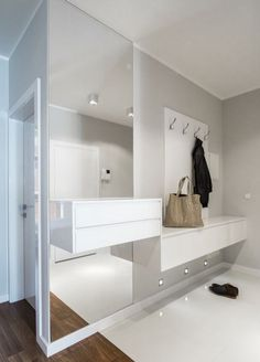 19 ideas for modern hall design and tips for the entrance area light gray wall paint and floor-to-ceiling wall mirror without frame, white hanging furniture Design Hall, Flur Design, Hanging Furniture, Hall Furniture, Furniture Stores, Home Entrance Decor, House Entrance, Home Decor, Entrance Ideas