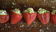 Savory stuffed strawberries with goat cheese and pistachios. And basil. And cream. Yum.